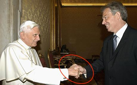 Pope Benedict XVI shakes hands with British Prime Minister Tony Blair during a private audience with Blair and wife Cherie at the Vatican. Do you notice a masonic handshake in the photo?